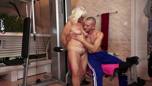 Young blonde haired sensual kissing at the gym