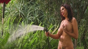 Solo busty & shaved mature Lisa Marie fingering outdoors