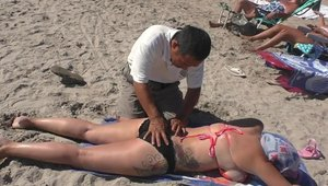 Massage at the beach in HD