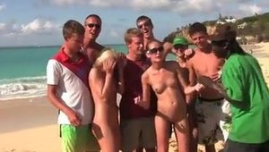 Naked lesbians fisting rub their clits together at the beach