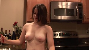 Big boobs brunette cooking in the kitchen