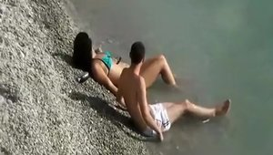 Couple goes in for caught ramming hard at the beach
